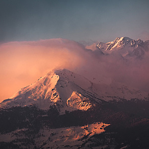 Red clouds cover distant mountains